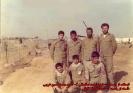 ایستاده از راست 1- شهید احمد اسفندانی 2- شهید محمد حسین غریبی و نشسته از راست 1- شهید علیرضا اتابکی